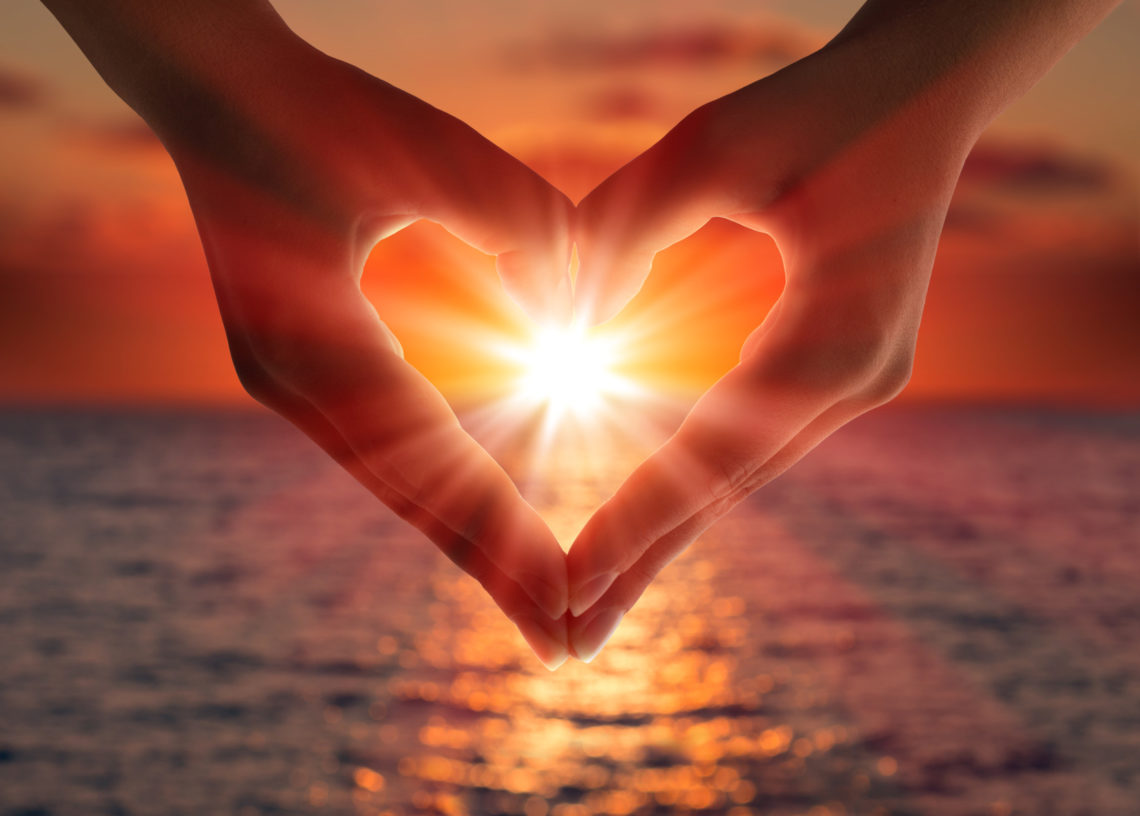 hands in shape of heart show love for gift of giving