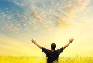 man arms toward sky life purpose