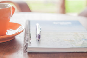 pen and notebook preparing for psychic readings